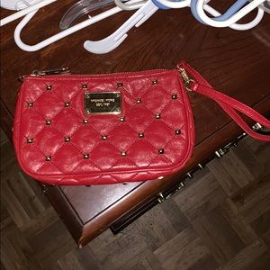 Red Michael Kors clutch with gold studs